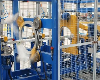 Automatic aluminum wrapping and tapping machine